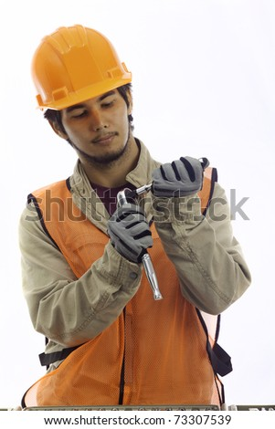 asian latino hard hat worker with his tools - stock photo