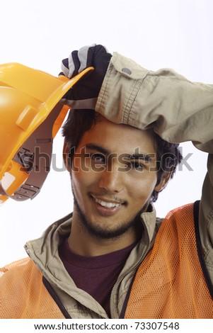 asian latino hardhat worker taking a break - stock photo