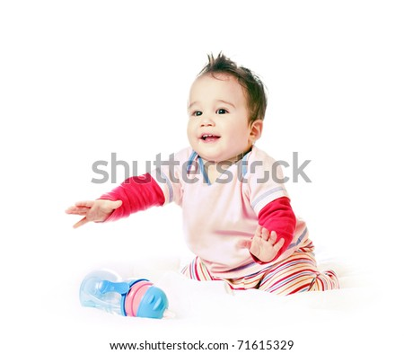 asian laughing baby boy with spout cup - stock photo
