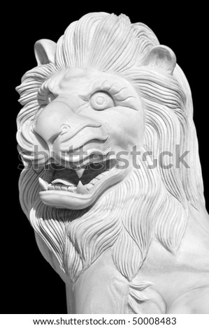 asian lion statue close-up over black
