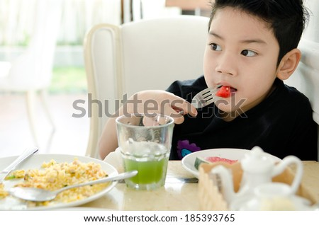 Asian Little boy eating slice of watermelon . - stock photo