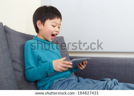 Asian little boy feel exciting for using tablet - stock photo
