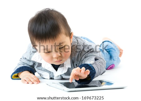 Asian little boy using digital tablet - stock photo