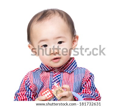 Asian little boy with wooden toy block