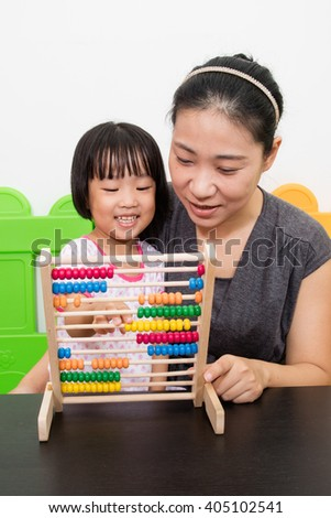 Asian Little Chinese Girl and Mother Playing Abacus Together at Playground - stock photo