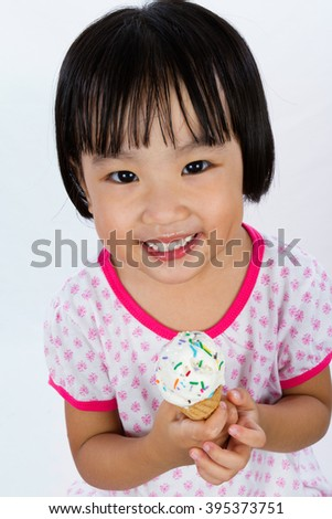 Asian Little Chinese Girl Eating Ice Cream isolated on White Background - stock photo