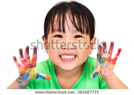 Asian Little Chinese Girl Playing and Painting isolated on White Background - stock photo
