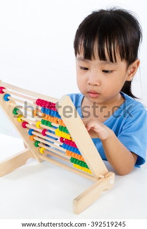 Asian Little Chinese Girl Playing Colorful Abacus isolated on White Background