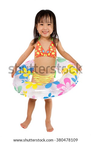 Asian Little Chinese Girl Playing with Swimming Ring isolated on White Background. - stock photo