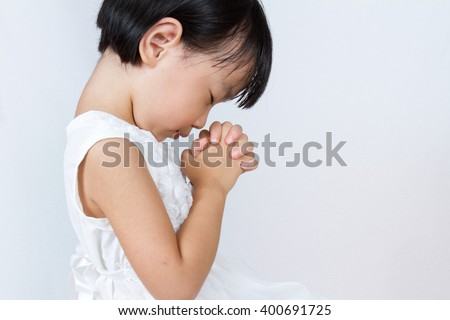 Asian Little Chinese Girl Praying in isolated White Background - stock photo