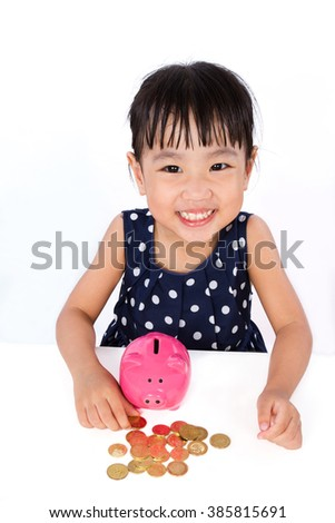 Asian Little Chinese Girl Saving Money in a Piggy Bank isolated on White Background