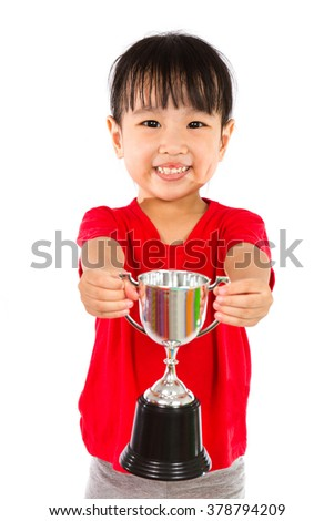 Asian Little Chinese Girl Smiles with a Trophy in Her Hands Isolated on White Background. - stock photo