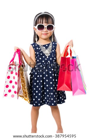 Asian Little Chinese Girl with Shopping Bag isolated on White Background - stock photo