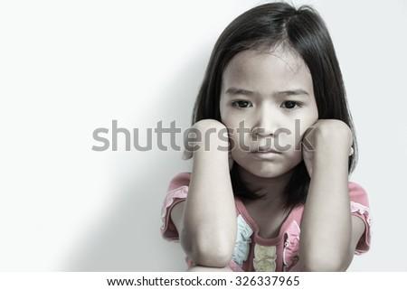 Asian little girl are sad. - stock photo
