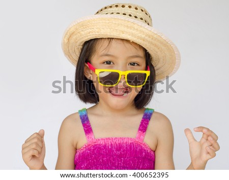 asian little girl are surprise with glass and hat