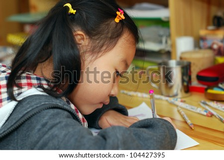 Asian little girl drawing
