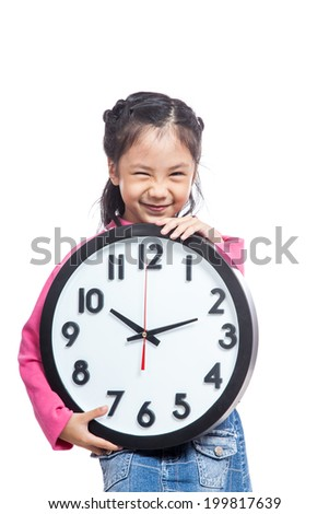 Asian little girl hold a clock and laughing isolated on white background - stock photo