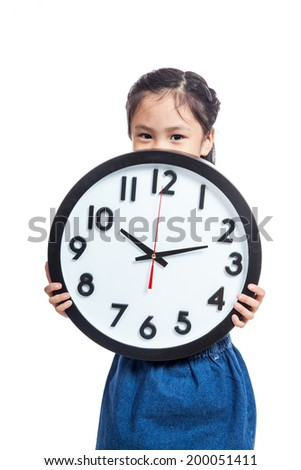 Asian little girl hold a clock close her mouth isolated on white background