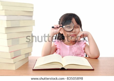 Asian little girl reading a book with magnifying glass isolated on a over white background - stock photo