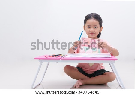 Asian little girl showing Thai baht banknote - stock photo