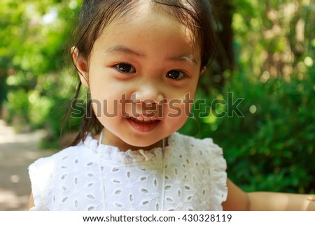 Asian little girl smile - stock photo