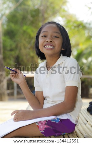 Asian little girl, student in countryside - stock photo