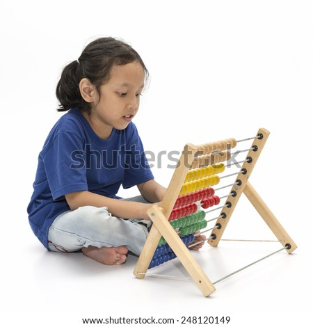 Asian little girl wearing blue shirt learn abacus over white background - stock photo