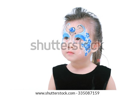Asian little girl with painted face - stock photo