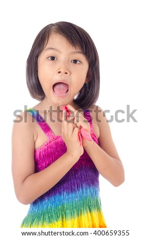 asian little girl with pink spoon and pink fork in hand