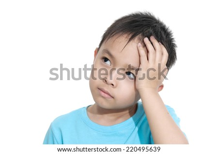 Asian little kid studying at home thinking - stock photo