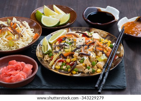 asian lunch - fried rice with tofu and vegetables, horizontal - stock photo
