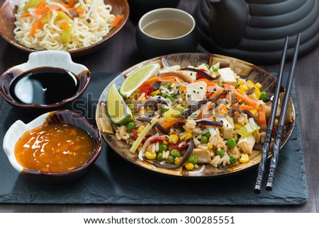 asian lunch - fried rice with tofu and vegetables, horizontal, close-up