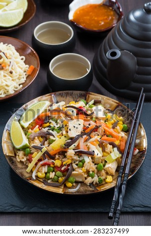 asian lunch - fried rice with tofu and vegetables, vertical, close-up