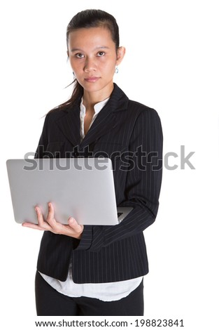Asian Malay businesswoman in a black suit with laptop over white background