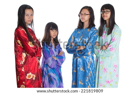 Asian Malay mother and daughters in traditional dress over white background