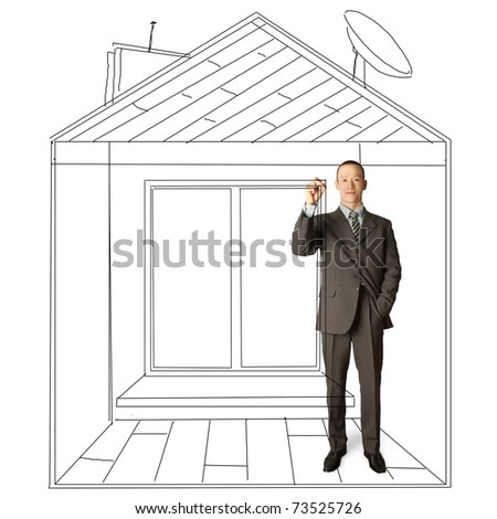 asian male businessman with marker in fictional house writing something on glass - stock photo