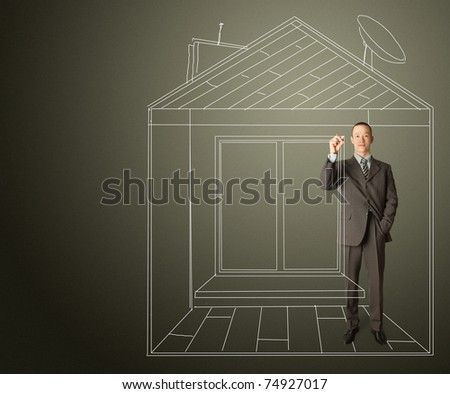 asian male businessman with marker in fictional house writing something on glass write board - stock photo