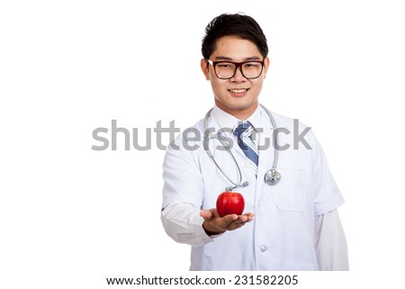 Asian male doctor smile with red apple  isolated on white background