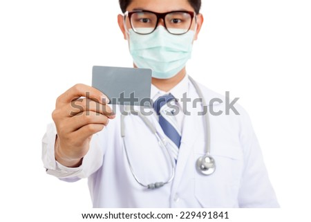 Asian male doctor wear mask with blank card  isolated on white background - stock photo