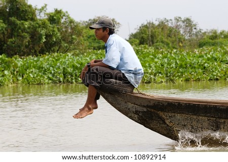 Asian male on the boat.