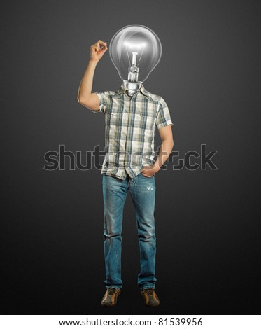 asian male with lamp writting something on glassboard with marker - stock photo