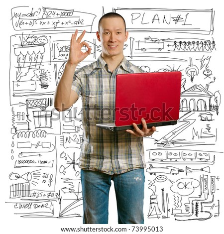 asian male with laptop in his hands shows OK, looking on camera - stock photo