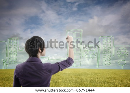 asian male with plan to develop sustainable city - stock photo