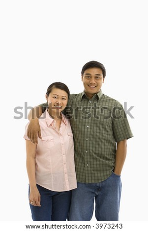 Asian man and woman standing with arms around each other.
