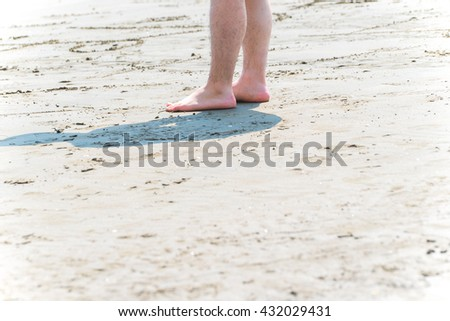 Asian man at the beach