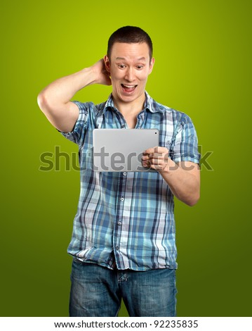 asian man businessman in suit with i pad in his hands - stock photo