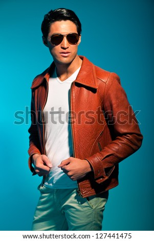 Asian man casual dressed with sunglasses. Summer fashion. Studio.