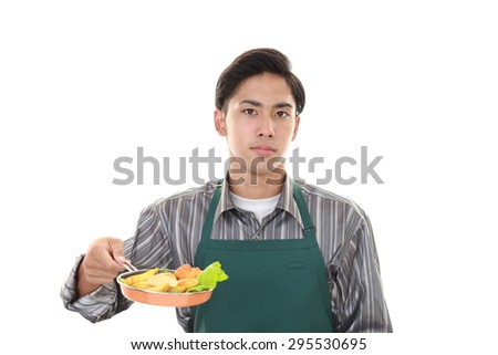 Asian man cooking healthy food - stock photo