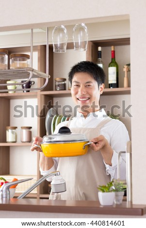 asian man cooking in the kitchen