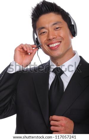 Asian Man customs service Representative talking on the phone - stock photo